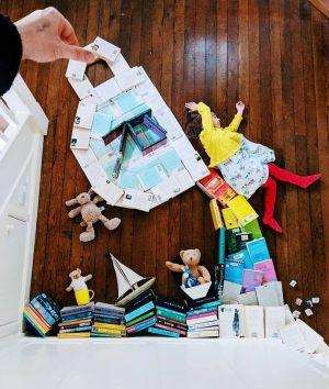 A teacup pouring rainbow books