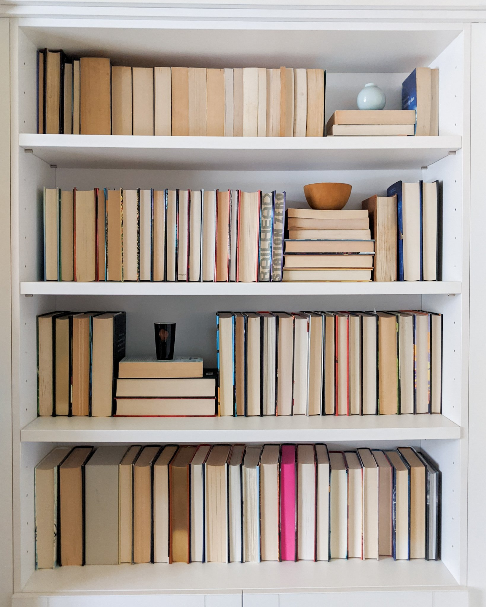 A-bookshelf-display-with-books-arranged-backwards so that the foreedge pages show